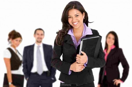 Smiley business woman with a group behind her, isolated